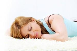 Blond beautiful woman sleeping on the floor.